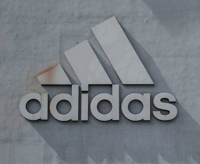 A large 3D model of the Adidas logo placed on the side of an Adidas office