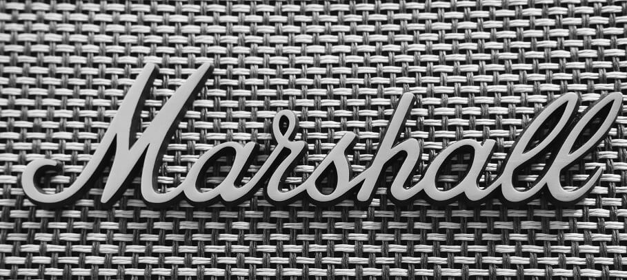 Marshall script logo attached on a grey Marshall speaker