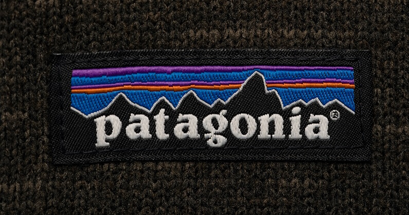 Patagonia logo tag stitched to a black Patagonia sweater